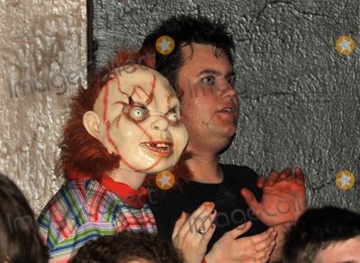 Chucky Photo - 31 October 2011 - Pittsburgh PA - Vocalist HAYLEY WILLIAMS of the band PARAMORE (in the Chucky mask) and JORDAN BROWN of the band SET YOUR GOALS watches the band NEW FOUND GLORY during their set on the Pop Punks Not Dead Tour 2011 held at the Altar Bar Hayley is the long time girlfriend of guitarist CHAD GILBERT of NEW FOUND GLORY Photo Credit Jason L NelsonAdMedia