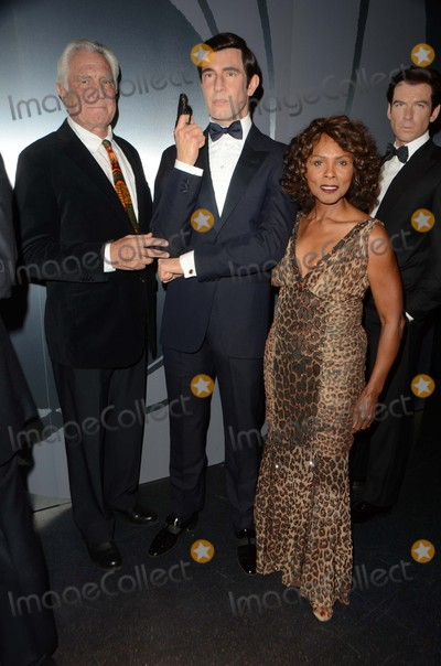 Gloria Hendry Photo - George Lazenby Gloria HendryMadame Tussauds Hollywood Reveals All Six James Bonds In Wax Madame Tussauds Hollywood CA 12-15-15