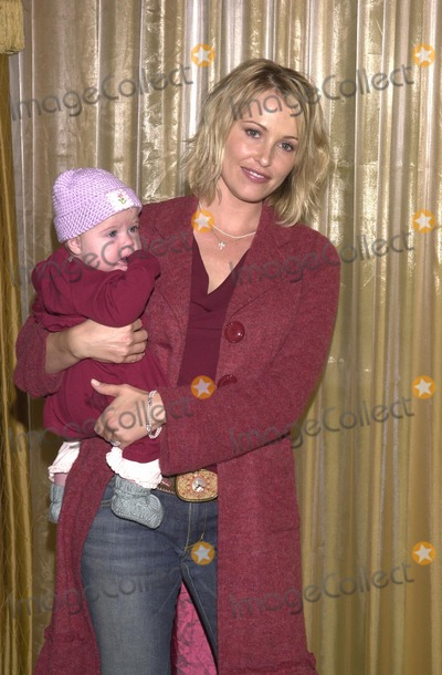 Josie Bissett Photo - Josie Bissett and baby at the Lullabies and Luxuries Fashion Show to benefit Caring for Children and Families with AIDS Regent Beverly Wilshire Beverly Hills CA 10-13-02