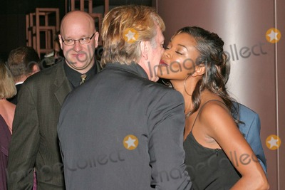 Gabrielle Union Photo - Gabrielle Union and  Alan Rickman with Producer Eric Hetzel at the Los Angeles Premiere HBO Films Something The Lord Made at the Directors Guild of America Los Angeles CA 05-20-04