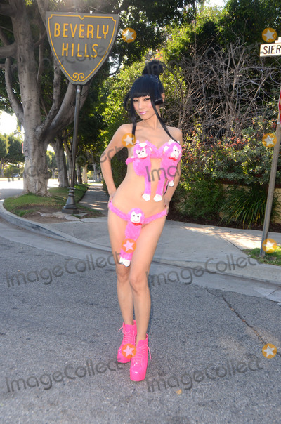 Bai Ling Photo - Bai Lingprepares for Chinese New Year (Feb 8) - The Year of the Monkey - by wearing a Hot Pink Monkey Bra out on the street in Beverly Hills CA 02-07-16