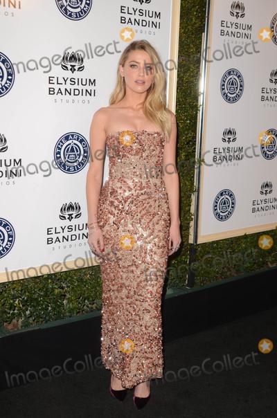 Amber Heard Photo - Amber Heardat the Art of Elysium 10th Annual Black Tie Heaven Gala Red Studios Los Angeles CA 01-07-17