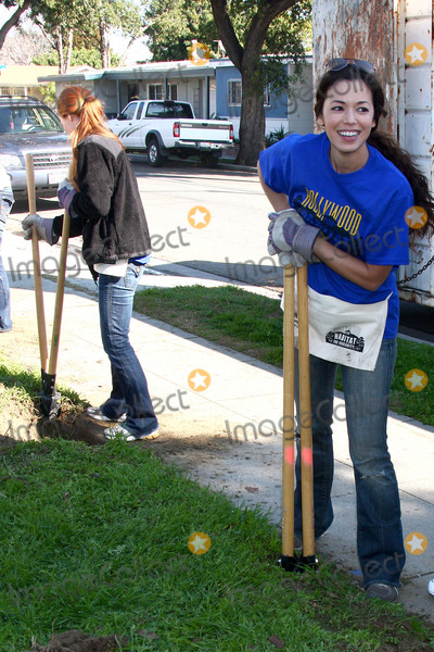 Hole Photo - LOS ANGELES - FEB 9  Theresa Castillo digging new fence post hole at the 4th General Hospital Habitat for Humanity Fan Build Day at the 191 E Marker Street on February 9 2013 in Long Beach CA
