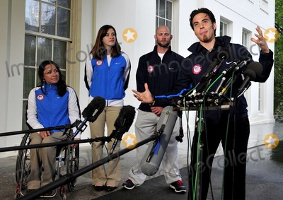 Alana Nichols Photo - Apolo Anton Ohno Olympic Short Track Speed Skater makes remarks to reporters after meeting United States President Barack Obama and first lady Michele Obama at the White House in Washington DC on Wednesday April 21 2010  From left to right Alana Nichols Paralympic Sit Skiier Katherine Reutter Olympic Speed Skater Heath Calhoun Paralympic Sit Skiier and Apolo OnoPhoto by Ron SachsPool-CNP-PHOTOlinknet