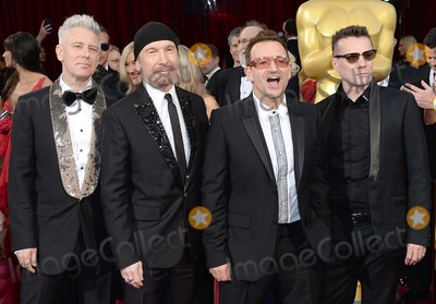 Adam Clayton Photo - Photo by Doug PetersstarmaxinccomSTAR MAX2014ALL RIGHTS RESERVEDTelephoneFax (212) 995-11963214Adam Clayton The Edge Bono and Larry Mullen Jr of U2 at the 86th Annual Academy Awards (Oscars)(Hollywood CA)