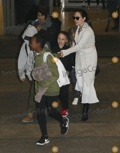 ANGELINA JOLIE Photo - Photo by gotpapstarmaxinccomSTAR MAX2017ALL RIGHTS RESERVEDTelephoneFax (212) 995-119631717Angelina Jolie and family are seen at LAX Airport in Los Angeles CA