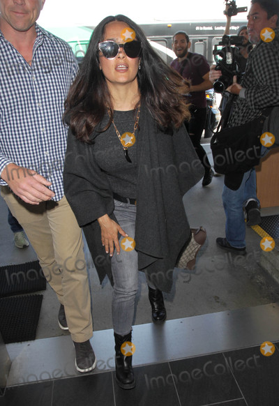 Salma Hayek Photo - Photo by MCRFstarmaxinccomSTAR MAX2017ALL RIGHTS RESERVEDTelephoneFax (212) 995-119641817Salma Hayek is seen at LAX Airport in Los Angeles CA