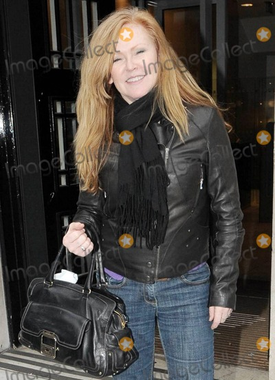 Carol Decker Photo - Singer Carol Decker 53 possibly best known for fronting the 1980s band TPau smiles for photographers outside of BBC Radio where she was promoting her latest tour London UK 111810