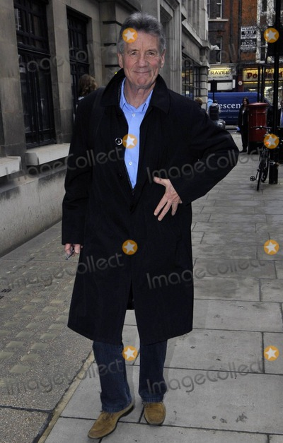 Monty Python Photo - UK comedian actor writer and television presenter best known for his work on Monty Python and his travel documentaries Michael Palin CBE FRGS grins at photographers as he leaves BBC Radio 2 London UK 11311