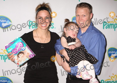 Noelle Pikus-Pace Photo - New York NY 03-18-2010Skeleton champion Noelle Pikus-Pace with husband Janson Pace and daughter Lacee at launch of Pampers Swaddlers and Cruisers with Dry Max at Helen MillsDigital photo by Lane Ericcson-PHOTOlinknet