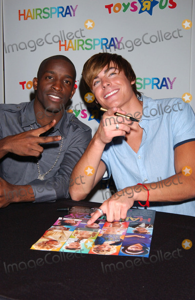 ZACK EFRON Photo - Elijah Kelley (L) and Zac Efron  a cast member from the movie Hairspray were at Toys R Us in Times Square to launch the new Hairspray dolls