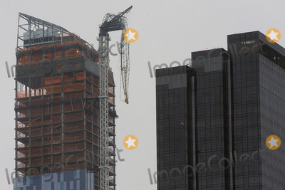 MANHATTAN SKYLINE Photo - October 29 2012 New York City A crane dangles over the Manhattan skyline at 157 West 57th Street after winds from hurricane Sandy cause it to collapse on October 29 2012 in New York City