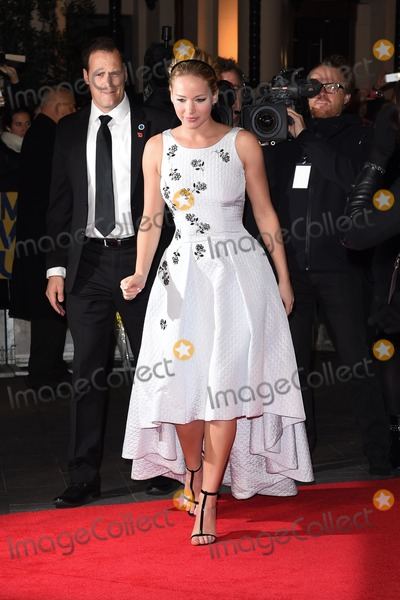 Jennifer Lawrence Photo - Jennifer Lawrence arriving for the world premiere of The Hunger Games Mockingjay Part 1 at the Odeon Leicester Square London 10112014 Picture by Steve Vas  Featureflash