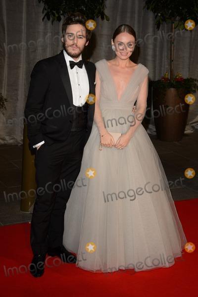 Sam Claflin Photo - Sam Claflin and Laura Haddock arrives for the BAFTA Film Awards 2015 dinner at the Grosvenor House Hotel London  08022015 Picture by Steve Vas Featureflash