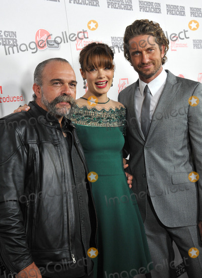 Sam Childers Photo - Gerard Butler (right) Michelle Monaghan  Sam Childers (upon whom the movie is based) at the Los Angeles premiere of their new movie Machine Gun Preacher at the Academy of Motion Picture Arts  Sciences Theatre Beverly HillsSeptember 21 2011  Los Angeles CAPicture Paul Smith  Featureflash