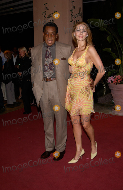 Don Cornelius Photo - Producer DON CORNELIUS  wife at pre-Grammy party given by Clive Davis of J Records at the Beverly Hills Hotel25FEB2002   Paul Smith  Featureflash