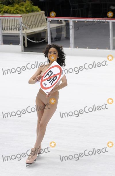 Tai Babilonia Photo - Olympic skater Tai Babilonia skates nude for PETA at Rockefeller Center in New York City on November 24 2009