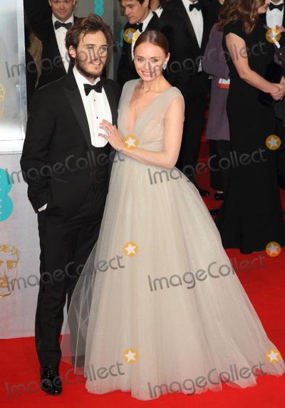 Sam Claflin Photo - London UK Sam Claflin and Laura Haddock  at the EE BAFTA British Academy Film Awards Red Carpet Arrivals at the Royal Opera House Covent Garden London 8th February  2015 RefLMK73-50550-090215Keith MayhewLandmark MediaWWWLMKMEDIACOM