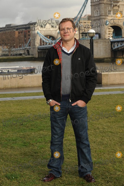 George Cole Photo - London UK Lex Shrapnel poses to launch Fives remake of the popular 80s sitcom starring Dennis Waterman and George Cole at Tower Bridge13 JanuaryAli KadinskyLandmark Media