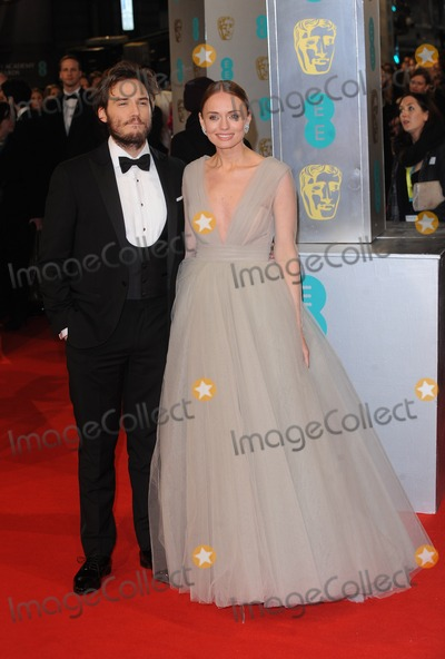 Sam Claflin Photo - London UK Sam Claflin and Laura Haddock at the EE BAFTA British Academy Film Awards Red Carpet Arrivals at the Royal Opera House Covent Garden London 8th February  2015 RefLMK200-50550-090215Landmark MediaWWWLMKMEDIACOM