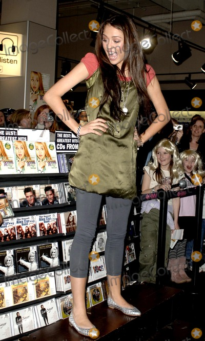 Hannah Montana Photo - London UK Miley Cyrus star of Disney Channels smash hit Hannah Montana makes a personal appearance to greet fans and sign copies of the Hannah Montana Behind the Spotlight DVD at HMVs Oxford Street store 27th March 2007Ali KadinskyLandmark Media