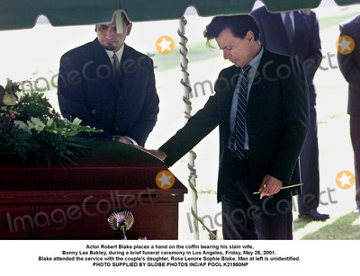 Bonnie Lee Bakley Photo - Actor Robert Blake places a hand on the coffin bearing his slain wife Bonny Lee Bakley during a brief funeral ceremony in Los Angeles Friday May 25 2001  Blake attended the service with the couples daughter Rose Lenore Sophie Blake Man at left is unidentified  PHOTO SUPPLIED BY GLOBE PHOTOS INCAP POOL K21950NP