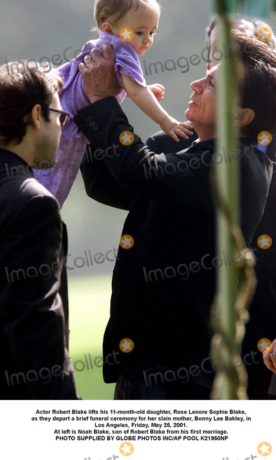 Sophie Blake Photo - Actor Robert Blake lifts his 11-month-old daughter Rose Lenore Sophie Blake as they depart a brief funeral ceremony for her slain mother Bonny Lee Bakley in Los Angeles Friday May 25 2001 At left is Noah Blake son of Robert Blake from his first marriage PHOTO SUPPLIED BY GLOBE PHOTOS INCAP POOL K21950NP