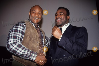 George Foreman Photo - Evander Holyfield with George Foreman Tvko Network Party 1990 L094z Photo by John Barrett-Globe Photos Inc