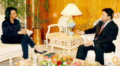 Pervez Musharraf Photo - K45560ISLAMABAD Oct12 - President Gen Pervez Musharraf discussing some point with US Secretary of State Condoleezza Rice during a meeting Rice promised long-term US help for Pakistan after an earthquake that killed more than 23000 people          Photo Zahid  PGP  OMEDIAS  Globe Photos Inc  2005