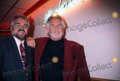 Kenny Rogers Photo - Kenny Rogers with Brother K4639rh 04181996 Donation to Gay Mens Health Crisis at Roasters Photo by Rose HartmanGlobe Photos Inc