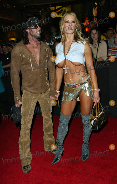 Joanie Laurer Photo - Joanie Laurer (Chynna) and Date X Pac  2002 Fox Billboard Bash at Studio 54 in the Mgm Grand Hotel in Las Vegas Nevada Photo by Fitzroy Barrett  Globe Photos Inc 12082002  K27911fb (D)