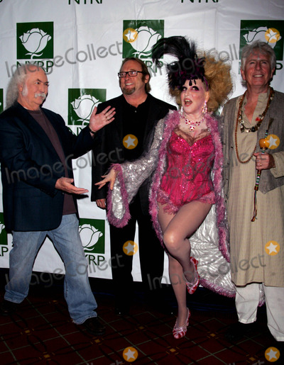 Bette Midler Photo - Bette Midler and Crosby Stills and Nash Arrive For the Hulaween Gala at the Waldorf Astoria in New York on October 30 2009 Photo by Sharon NeetlesGlobe Photos Inc