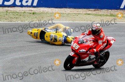 Alex Barros Photo - LISBON PORTUGAL The Moto GP competition race Italian Racer Valentino Rossi won Portugal Moto GP Makoto Tamada (Japan) was second and Alex Barros (Brazil) was third In photo Italian racer Max Biaggi fell during the race and had to leave the competition952004PHOTO ALVARO ISIDOROCITYFILESGLOBE PHOTOS INC  2004K39151