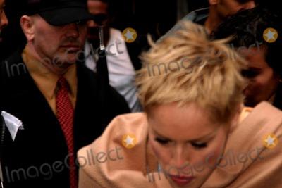Sharon Stone Photo - Sharon Stone and Dakota Fanning Departing Good Morning America  Gma From the Abc Studios in Times Squarenew York City 04212004 Photo Rick Mackler RangefindersGlobe Photos Inc 2004 Sharon Stone
