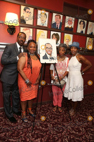 Courtney B Vance Photo - Courney B Vance Caricature Unveiling Sardis NYC July 2 2013 Photos by Sonia Moskowitz Globe Photos Inc 2013 Angela Bassett Courtney B Vance and Family Members