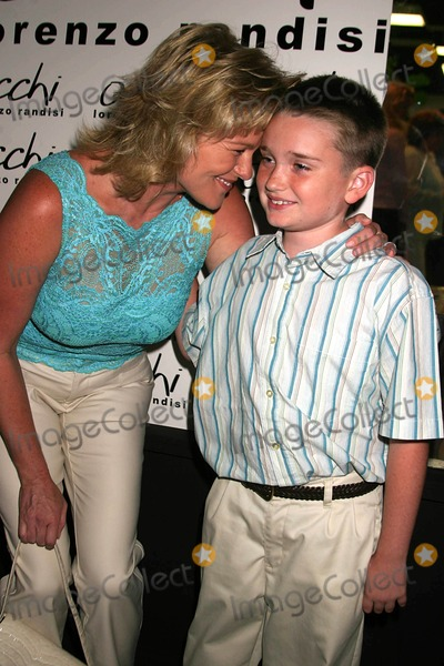 Austin Luciano Photo - Occhi Eye Boutique Grand Opening Hosted by Lorenzo Randisi Occhi West Hollywood CA 08-30-2005 Photo Clinton Hwallace-ipol-Globe Photos Inc Judi Evans Luciano and Son Austin Luciano