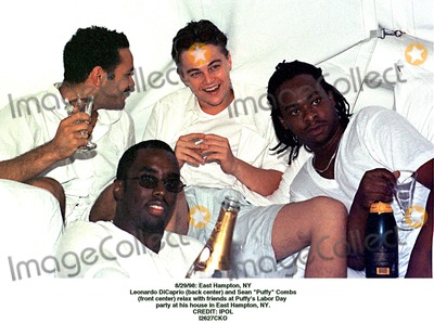 Sean Puffy Combs Photo - 2998 East Hampton NY Leonardo Dicapprio (Back Center) and Sean Puffy Combs (Front Center) Relax with Friends at Puffys Labor Day Party at His House in East Hampton NY Credit Ipol I2627cko Credit Photographer NameipolGlobe Photos Inc