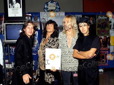 Aerosmith Photo - Steven Tyler and Tom Hamilton (From Aerosmith) with Dave Sharpe and Eddie Macdonald (From Alarm) Photo Michael a Gallitelli  Globe Photos Inc