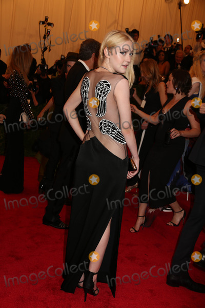 Dakota Fanning Photo - The Metropolitan Museum of Art Costume Institute Gala Celebrating the Exhibition punkchaos to Couture the Metropolitan Museum of Art NYC May 6 2013 Photos by Sonia Moskowitz Globe Photos 2013 Dakota Fanning