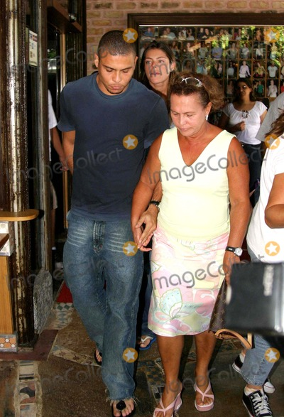 Daniela Cicarelli Photo - K41343RIO DE JANEIRO BRAZIL Ronaldo Real Madrid football player and his fiancee Daniela Cicarelli leaving Porcao Restaurant with his parents Ronaldo and Daniela are in Brazil to solve some family problems before their wedding next February 14 According to the players friends some Ronaldos relatives may have to arrange valid documentation to attend the couples marriage in Paris On the picture Daniela Ronaldo and his mother Sonia   EXCLUSIVE01-30-2005PHOTO CLEOMIR TAVARESCITY FILESGLOBE PHOTOSINC
