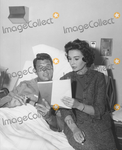 Rock Hudson Photo - Jean Simmons with Rock Hudson Working on  This Earth Is Mine Supplied by Globe Photos Inc