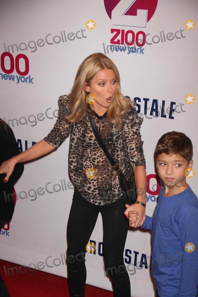 Kelly Ripa Photo - Kelly Ripa and Her Kid in Pressroom at Z100s Jingle Ball Concert at Madison Square Garden 12-7-2012 Photo by John BarrettGlobe Photos