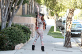 Photos From Phoebe Price Sighting in a sheer outfit while getting mail