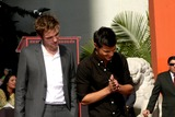 Robert Pattinson,Taylor Lautner Photo - Handprint and Footprint Ceremony for the Twilight Saga Actors Pattinson Stewart and Lautner