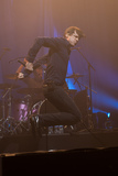 Photos From Suede performing behind a curtain projecting photographer Roger Sargent's film  Night Thoughts