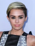 Miley Cyrus Photos - Miley Cyrus attending the Los Angeles Premiere of Paranoia Held at the Directors Guild of America in Los Angeles California on August 8 2013 Photo by D Long- Globe Photos Inc