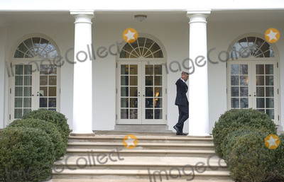 President Barack Obama Photo - President Barack Obama walks on the colonnade after leaving the Oval Office for the last time as President in Washington DC on January 20 2017 Later today President-Elect Donald Trump will be sworn-in as the 45th President Photo Credit Kevin DietschCNPAdMedia