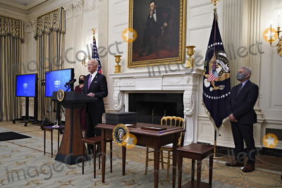 Anthony Fauci Photo - United States President Joe Biden speaks as US Vice President Kamala Harris left and Anthony Fauci director of the National Institute of Allergy and Infectious Diseases right listen during an event on his administrations Covid-19 response in the State Dining Room of the White House in Washington DC US on Thursday Jan 21 2021 Biden in his first full day in office plans to issue a sweeping set of executive orders to tackle the raging Covid-19 pandemic that will rapidly reverse or refashion many of his predecessors most heavily criticized policies Credit Al Drago  Pool via CNPAdMedia