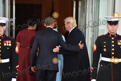 Barack Obama Photo - President Barack Obama (C) escorts President-elect Donald Trump and wife Melania into the White House for tea before the inauguration on January 20 2017 in Washington DC  Trump becomes the 45th President of the United States Photo Credit Kevin DietschCNPAdMedia