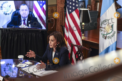 Kamala Harris Photo - United States Vice President Kamala Harris lower center speaks during a virtual bilateral meeting with President Alejandro Giammattei of Guatemala on screen at upper left in the Vice Presidents Ceremonial Office in the Eisenhower Executive Office Building on the White House campus about the migration crisis on April 26 2021 in Washington DC Credit Oliver Contreras  Pool via CNPAdMedia